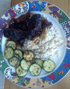 Slow-cooked barbecued chicken with sauteed zucchini and brown rice